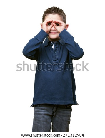 little kid doing a glasses gesture - stock photo
