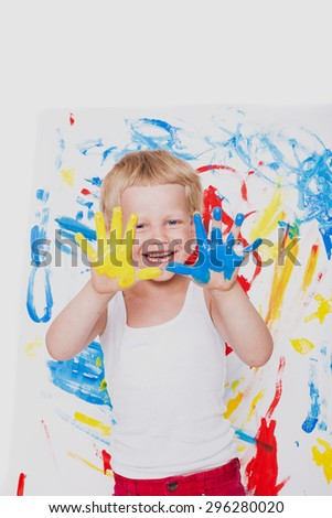 Little kid draws bright colors. School. Preschool. Education. Creativity. Studio portrait over white background - stock photo