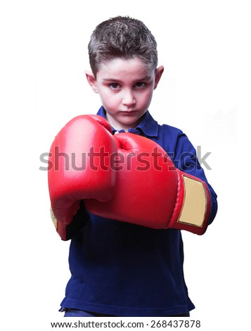 little kid fighting with red boxing gloves