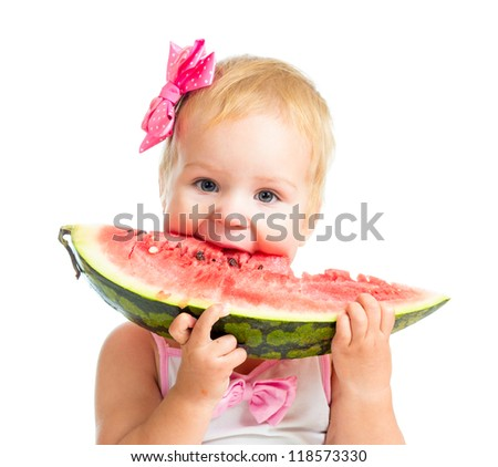 Little kid girl eating watermelon isolated on white background - stock photo
