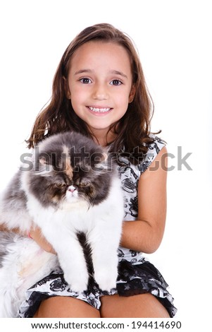little kid girl showing love to her persian kitten - stock photo