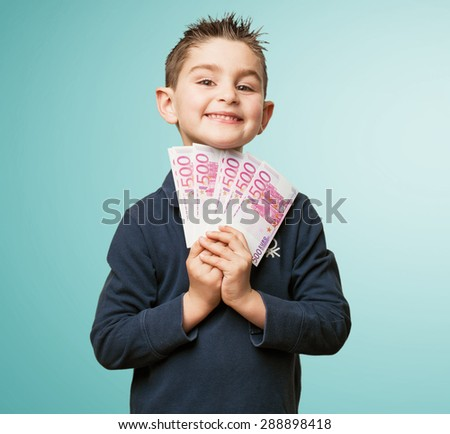 little kid holding banknotes - stock photo