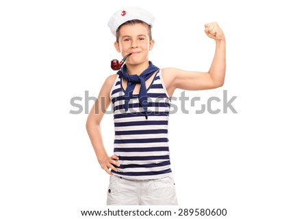 Little kid in sailor outfit showing his bicep and holding a pipe in his mouth isolated on white background - stock photo
