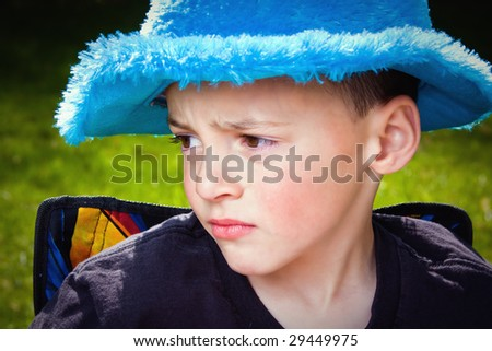 Little Kid Looking Away with a Sad Expression