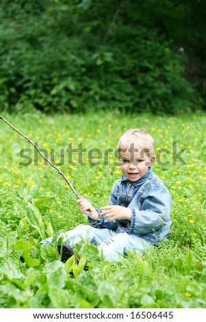 Little kid on green grass