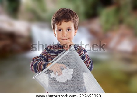 Little kid on the outside throwing a paper in the bin. - stock photo
