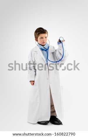 Little Kid playing Doctor - stock photo