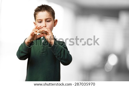 little kid playing flute