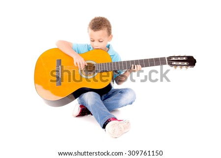 little kid playing guitar isolated in white