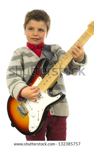 little kid rocking on a electric guitar