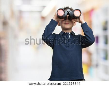little kid using binoculars - stock photo