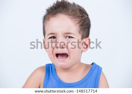 Little kid with tears on his eyes - stock photo