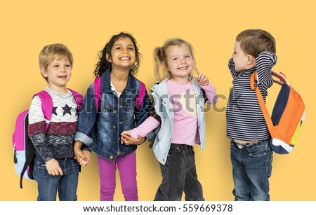 Little Kids Holding Hands Carrying Backpacks
