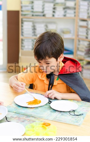 Little kids in classroom painting and crafting - stock photo