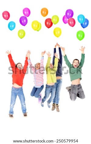little kids playing with balloons isolated in white - stock photo