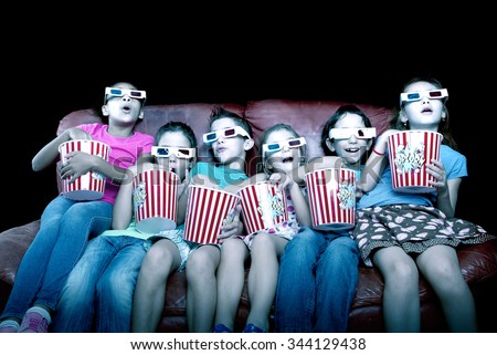 little kids watching movies with 3d glasses