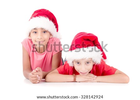 little kids with christmas hat