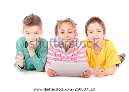 little kids with tablet isolated in white - stock photo