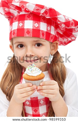 Little kitchen fairy holding muffin - closeup - stock photo