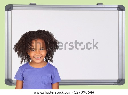 Little latine student with a white blackboard of background - stock photo