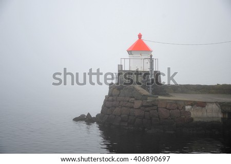 Little lighthouse in thick fog