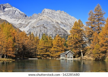 Little log cabins by Palpuogna Lake in Engadina, Switzerland (CH)