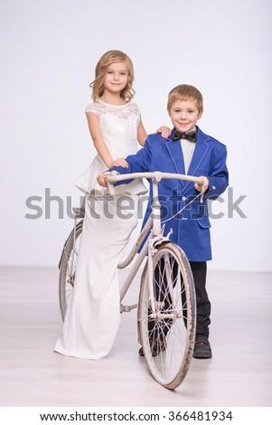 Little loving couple  celebrating wedding  - stock photo