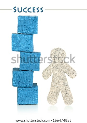 Little man and building blocks isolated on white