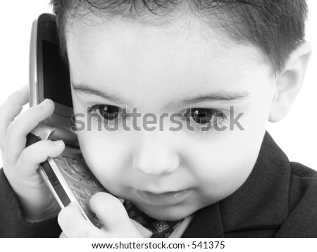 Little man discussing important business on the cell phone in black and white. - stock photo