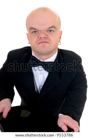 Little man, dwarf in a formal suit with bow tie, studio shot, white background - stock photo