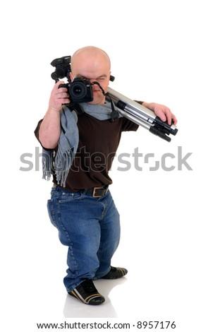 Little man, dwarf photographer with tripod and DSLR camera, studio shot, white background - stock photo