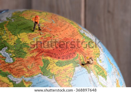 Little mans climbing on school globe. Concept sport, recreation. - stock photo