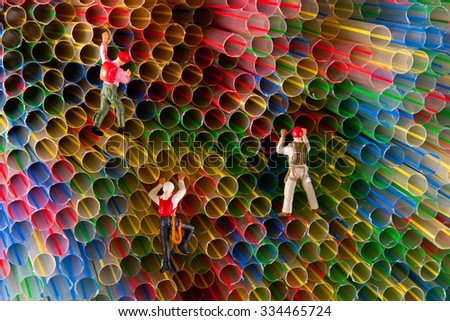 Little mans climbing on straws. Concept sport, recreation. - stock photo