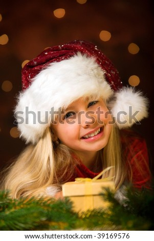 little miss santa with a gift - stock photo