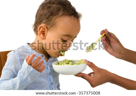 Little 18 month African toddler boy refusing to eat his vegetables - stock photo