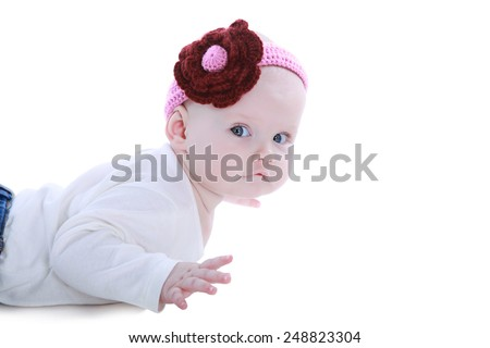 little 6-month girl lying, isolated