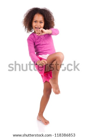 Little muay thai boxing girl using her knee,isolated on white background
