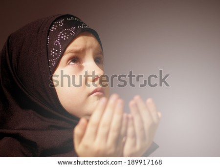 Little muslim girl praying - stock photo
