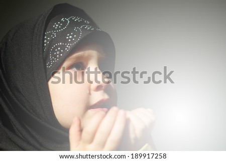 Little muslim girl praying - stock photo