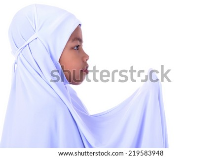 Little Muslim girl praying, isolated white - stock photo
