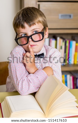 little nerdy boy with geeky goggles,doing silent gesture - stock photo