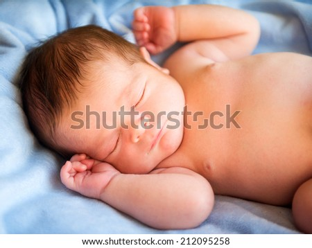 Little newborn baby  - stock photo