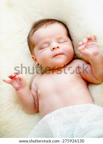 Little newborn baby boy 14 days, sleeps - stock photo