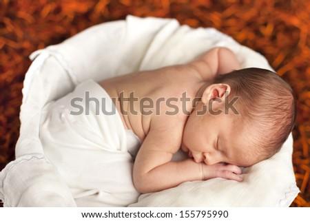 Little newborn baby boy sleeping - stock photo