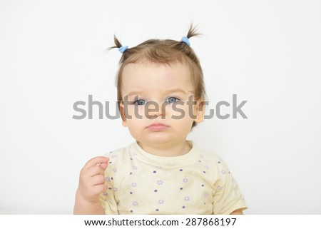 Little newborn baby girl. Parenting or love concept. Sad tired child.