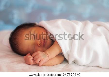 Little newborn baby sleeps - stock photo