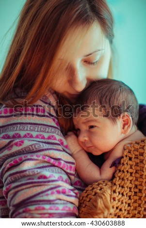little newborn in the arms of his mother - stock photo
