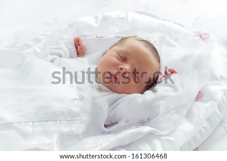 Little Newborn Sleeping over His White Bed - stock photo