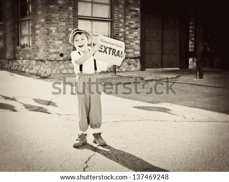 "Little old newsboy holding out the newspaper and yelling ""Extra"" - stock photo"