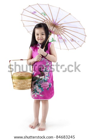 Little oriental girl in traditional Chinese dress cheongsam with umbrella and basket - stock photo